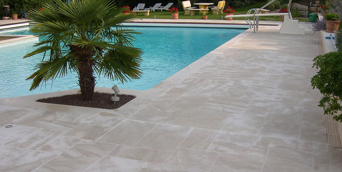 Semond stone shades around a pool